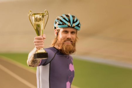 cyclist with champion cup