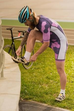 cyclist tying shoelaces