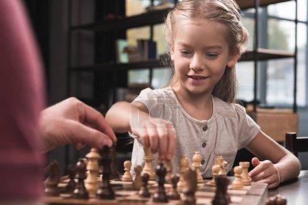 Preschooler kid playing chess