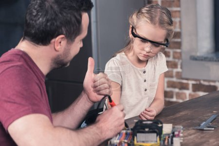 Photo for Father showing thumb up to daughter for brazing - Royalty Free Image