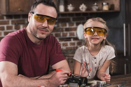 Photo for Father and daughter posing while brazing at home - Royalty Free Image