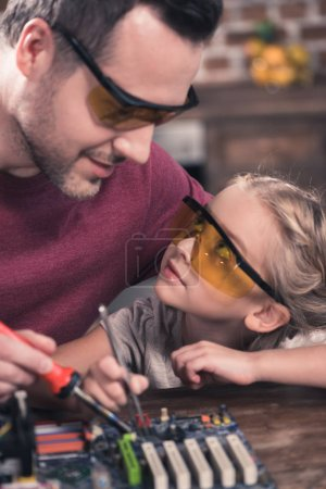 Photo for Close up view of father teaching daughter to braze - Royalty Free Image