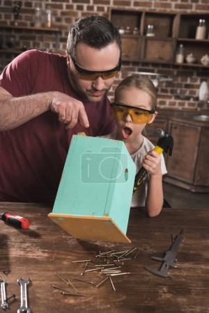 Daughter surprised to birdhouse