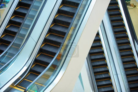 Escalator and empty modern shopping mall interior....