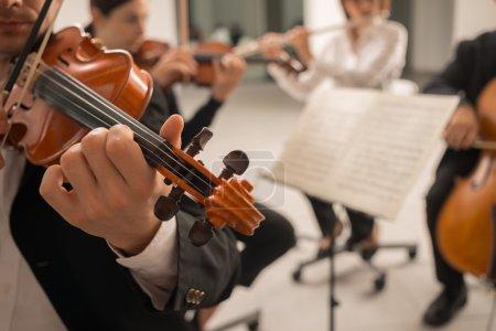 Violinist performing on stage