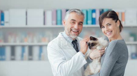 woman with cat at veterinary clinic
