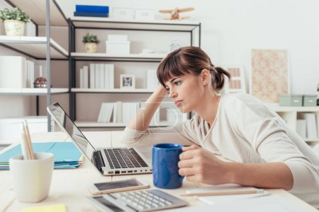 Tired woman at office desk