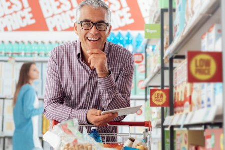 Confident man doing grocery shopping