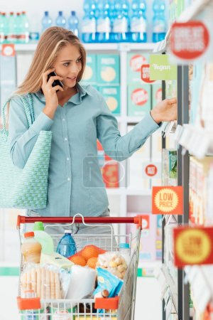 Woman having a phone call at the store