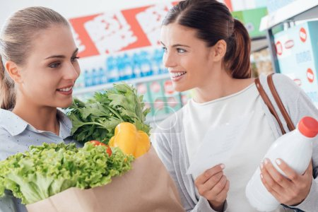 Women shopping together at supermarket
