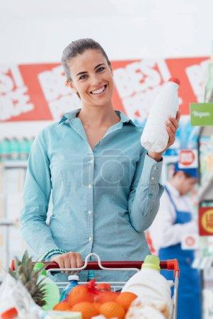 Happy woman shopping at supermarket