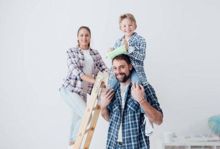 Happy family renovating new home