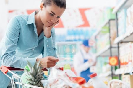 Woman checking shopping list
