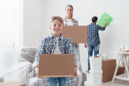 boy and mother carrying boxes