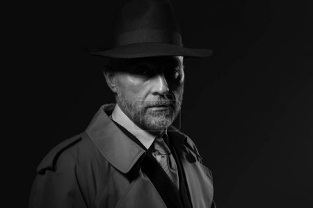 man wearing hat and trench coat