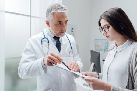 Doctor explaining test results to patient