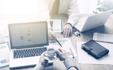 Business partners working at office desk