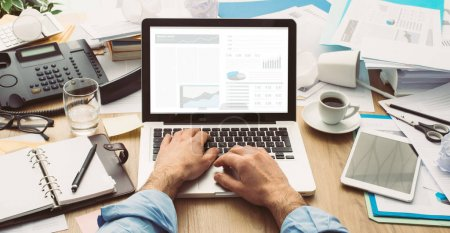 businessman typing with laptop
