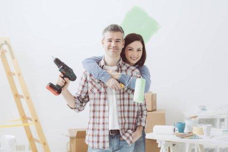 loving couple doing home renovations