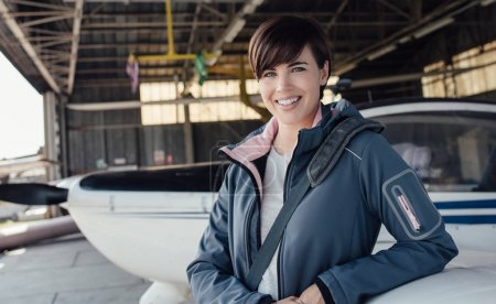 Young smiling female pilot