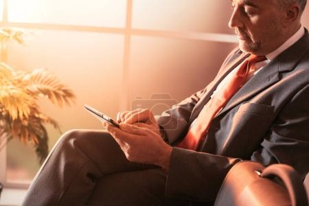 businessman connecting with digital tablet,