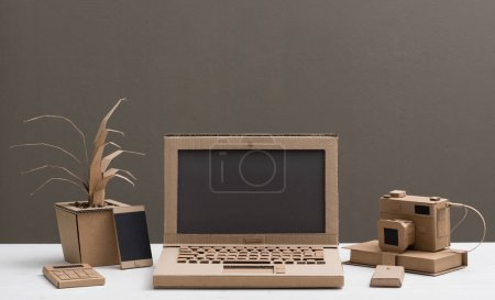 Photo for Eco-friendly creative office items and laptop made from recycled cardboard, crafts and ecology concept - Royalty Free Image
