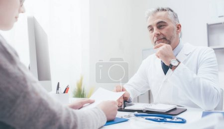doctor meeting with patient in office