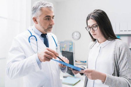 Doctor explaining medical test results to the patient
