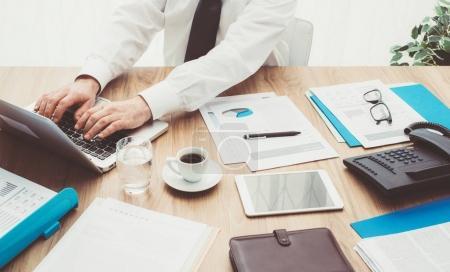 corporate businessman using laptop