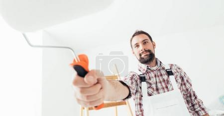 Professional painter working and painting