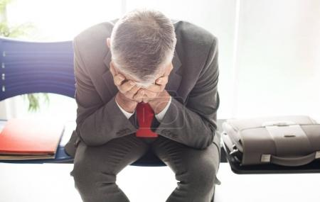 Desperate businessman in waiting room