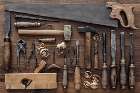 Vintage woodworking tools on workbench