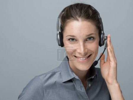 Smiling beautiful woman with headset