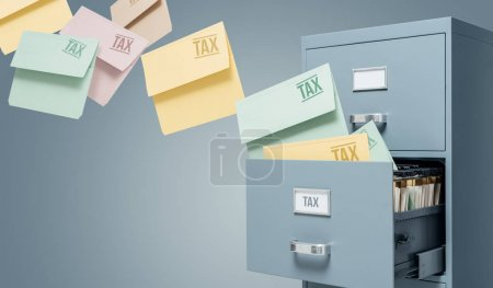Tax files transferring into filing cabinet