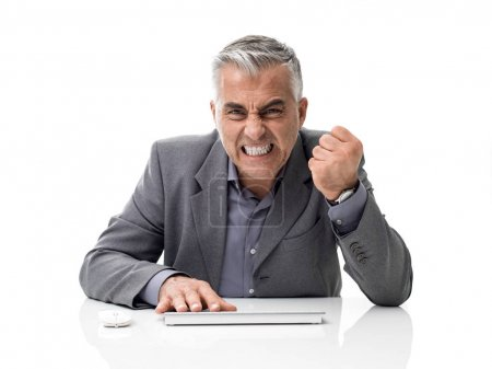 Photo for Angry stressed businessman yelling at his computer, overwork and computer problems concept - Royalty Free Image