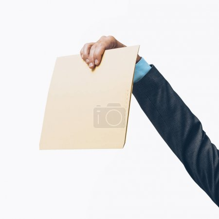 Corporate businessman holding a file