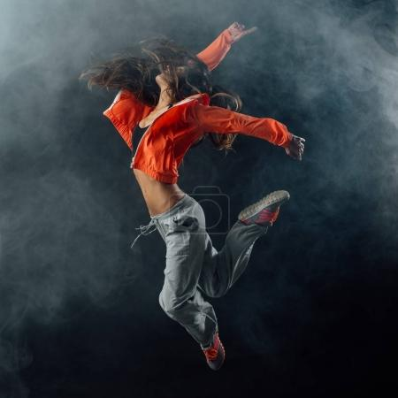 Young dancer jumping and performing