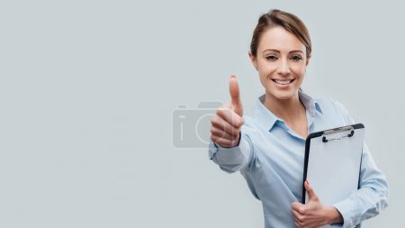 businesswoman giving thumb up