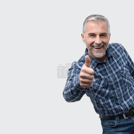 Cheerful man giving a thumb up