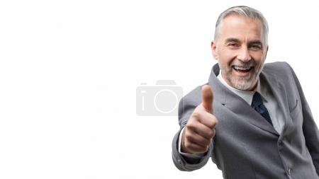 corporate businessman giving thumbs up