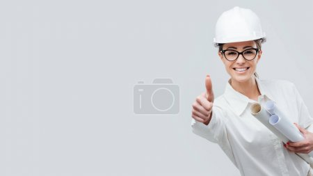 female architect giving thumbs up
