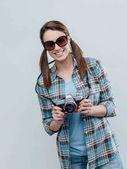 female photographer holding camera
