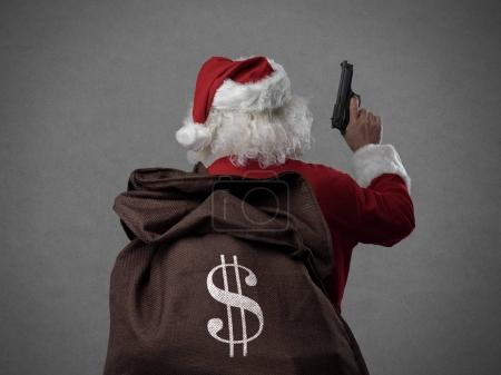 Santa Claus holding gun