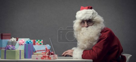 Santa Claus connecting with his laptop