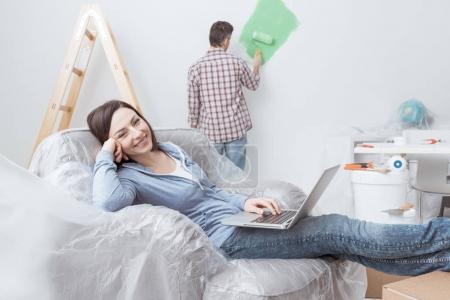 Happy couple doing home renovations