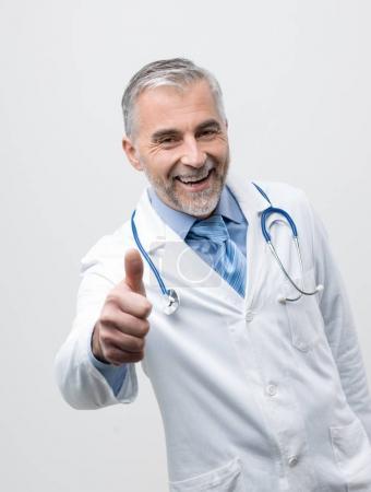 Confident smiling mature doctor