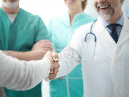 confident doctor shaking patients hand