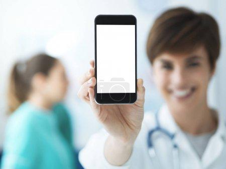 Female doctor holding smartphone