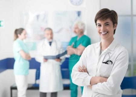 female doctor posing at clinic