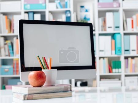 Students desktop with computer